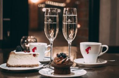Restaurant table with champagne and dessert